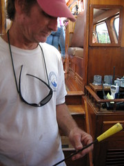 Captain Bob Wallace holds an arrow used to collect whale blubber.
