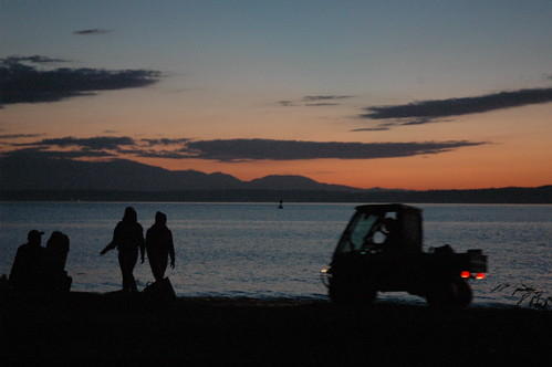People walking, Golden gardens patrol cart, twilight, Seattle, Washington, USA by Wonderlane