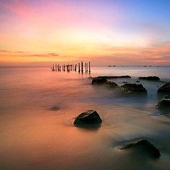 Another side of Ampenan [Explored] (Randi Ang) Tags: longexposure sunset seascape beach beauty rock canon indonesia landscape island eos harbor pier twilight jetty 5d lombok waterscape ef1740mmf4l ampenan westnusatenggara nusatenggarabarat exharbor