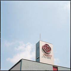 (masaaki miyara) Tags: sky clock 120 6x6 japan architecture mediumformat logo factory kamakura hasselblad shade fujifilm 100 aug   2010 shiseido 500cm fujicolor superg      logotypo  logosymbol