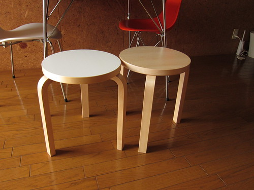 a pair of artek STOOL 60