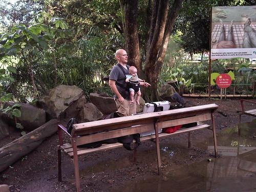 Drew bounces Cole around on location in Medellin's botanical gardens.