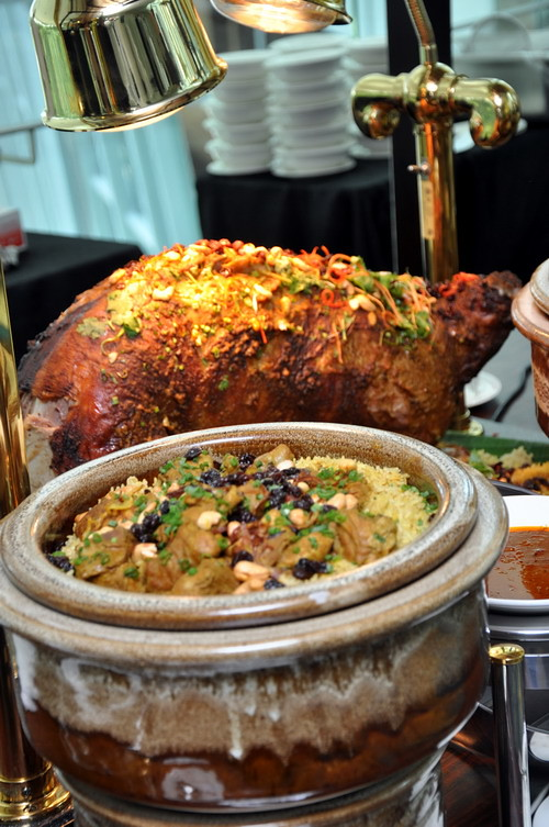 Whole roasted lamb kuzi served with briyani rice