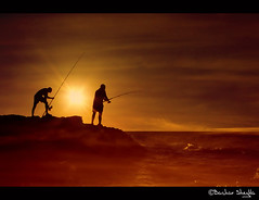 The Dark Sea ! (Bashar Shglila) Tags: sunset sea sun fish men beach silhouette fishing rays libya     mygearandmepremium mygearandmebronze mygearandmesilver mygearandmegold dblringexcellence