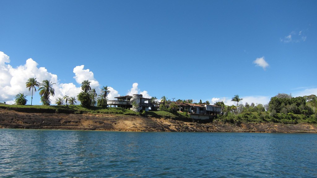 The view from behind of Pablo Escobar's house on Lake Penol (right), and that of his bodyguards (left).