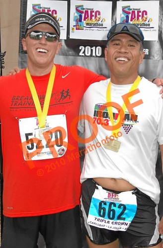 Eric and I celebrating after a good race. Please ignore my belly button.