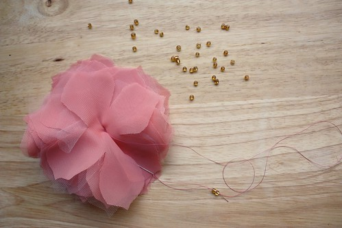 Step 8: Sew Embellishment to Top Center of Flower