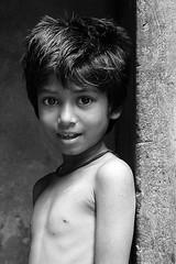 Surprised Look (Russell John) Tags: bw girl monochrome kids child suprised dhaka 1855mm oldtown bangladesh chilldren explored 450d russelljohn