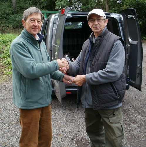 Dave Mann handing over the proceeds from the day to Don Simpson