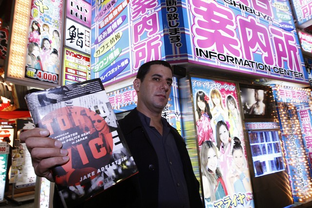 Jake Adelstein with his book, Tokyo Vice