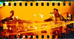 Sprocket Rocket (Irene Miranda) Tags: city cars film miguel angel lights luces lomography hands arms ciudad manos holes rocket irene mm miranda 35 coches sprocket analogic brazos sobreexposicion agujeros analogico emav revelado xevi redscale pelicua