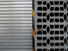 Split Moucharabieh (Gabri Le Cabri) Tags: black paris yellow metal wall silver concrete vent grey stripe shutter 75018 moucharabieh paris18 noncoloursincolour