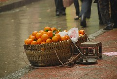 By the Curb, After Rain (faungg's photo) Tags: china street orange fruit nikon view sale scene snap  chongqing    18200mm  d40x