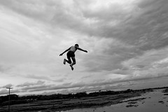 I wish i could fly... (Shad0w_0f_Dark) Tags: bridge boy sky bw water clouds canon river jump child dhaka tamron 2010 travelphoto karanigonj
