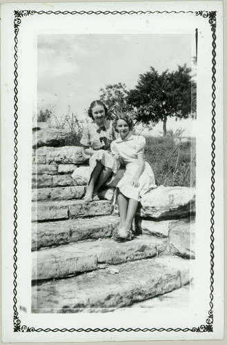 two girls on rock steps