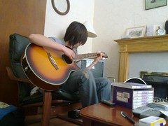 Jara playing guitar