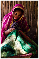 The Raconteur [..Chuadanga, Bangladesh..] (Catch the dream) Tags: light woman smile rural village sew story needle housewife weaving bangladesh maiden threads contemplation kantha artistry clothe sweing cottageindustry chuadanga nokshikantha gettyimagesbangladeshq2