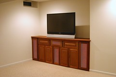 Newtown PA 1 LCD, Lutron lighting, theater seating, equipment in cabinet, remote, & built in speakers