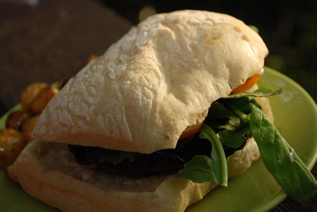 portobello sandwich with aioli, tomatoes, and rocket