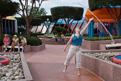 Sarah practicing her waterbending. (colorblindPICASO) Tags: water fountain sarah epcot jump rocks stream reaching tummy barefoot almost splash wdw waltdisneyworld epcotcenter tiptoes blondhair braidedhair noshoes reachingup descala descalza piedsnus piedinudi scalza bluetanktop