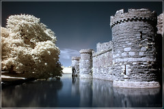 Beaumaris Castle in IR (Ben Locke (Ben909)) Tags: castle wales ir infrared moat beaumaris acqua castello hoya riflesso anglesey northwales r72 beaumariscastle fossato