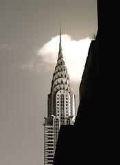 Chrysler building (nikonman3) Tags: street camera city nyc newyorkcity travel sky urban blackandwhite bw ny newyork building classic monochrome vertical skyline architecture clouds digital america liberty photography freedom blackwhite cityscape afternoon shadows d70 metro details d70s iphoto chryslerbuilding godblessamerica gotham manhatten flicker urbanlandscape 1870 nikonflickeraward newyorkcityd70s nikonflikeraward