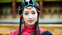 Tibetan. Young. (Jonathan Kos-Read) Tags: china red portrait girl beautiful asian bigeyes tv asia chinese young deep lips tibet shangrila teen actress tibetan braids yunnan monalisasmile minority gaze nineteen chinesecinema asiancinema chinesefilm asianfilm asianactress asianeyes chinesetv hotasiangirl hotchinesegirl asiantv chineseactress chineseeyes nikonflickraward asianshowbusiness chineseshowbusiness
