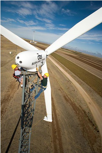 80 feet above ARS's Bushland, Texas, research station, agricultural engineer Byron Neal (right), of ARS, and mechanical engineer Adam Holman, of the Alternative Energy Institute, West Texas A&M University, perform quarterly service on a wind turbine.