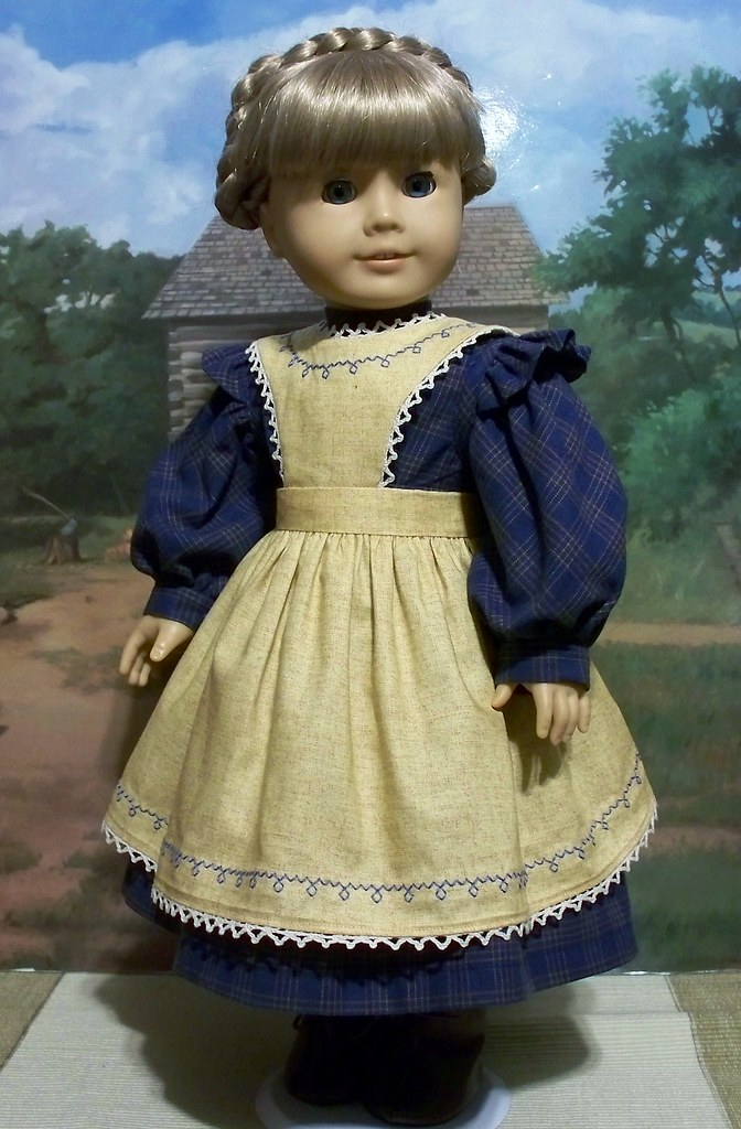 Medium blue prairie dress and gold colored apron