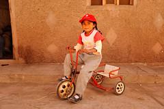Bicycle tricycle take me far (JonBauer) Tags: peru cuzco nikon rocks village cusco perú dirt littlegirl deteriorated andahuaylillas d700 2470mmf28g rustytricycle
