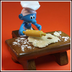 Rolling it out (Rigib) Tags: blue macro square toy miniature cut roll biscuits smurf flour bake rollingpin schlumpf pitufo schtroumpf canon60mmmacro 2inch smurfvillage puffo img2336 bakersmurf alsanafer