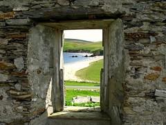 The Window (headless.chicken.) Tags: road old sea beach window grass stone scotland sand rocks waves sheep hills yell oldbuilding shetland unst mygearandmepremium mygearandmebronze