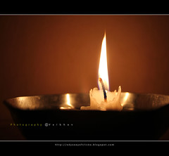 Light of Truth (Vaibhav - Odyssey) Tags: light orange reflection yellow glitter dinner glow candle flame wax shining