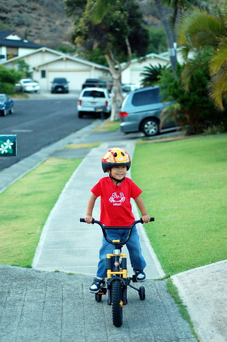 Owen riding his bicycle to go watch the Tinman Triathlon bicycle segment