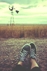 I'm just sitting here wathing the wheels go 'round and 'round (enjoythelittlethings) Tags: road sky feet windmill skyline self vintage landscape mt wheat raleigh retro converse 365 molt tones chucks gravel cliche foreground wheatfields ummm hcs moltmt canon50d iwantsomewingstoday ormaybeishouldjusthavebreakfast