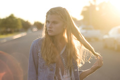 goldy locks (victoriacarlson) Tags: road sunset woman sun sunlight cars girl shirt standing hair long hand sundown jean bright feather flare teenager 70s seventies jackets braid grabbed