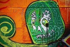 frothy head green (Studiobaker) Tags: street urban orange streetart black green art minnesota monster yellow wall spiral concrete outside graffiti eyes exterior arm head teeth minneapolis neil bubbles ne drip fluid mpls octopus sandman frothy jagged block mutant piece tentacle northeast mn bubbly gaiman froth nordeast studiobaker
