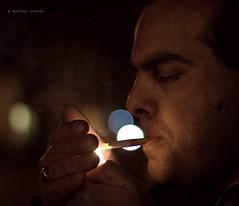 Gangsters Paradise (Tato C) Tags: light face night fire noche hand bokeh cigarette smoke cara ring mano fuego humo anillo cigarrillo lumbre