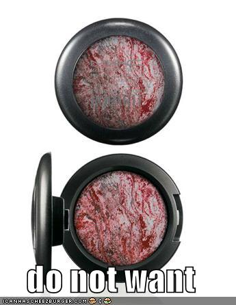 A samle eyeshadow compact from the Juarez line. The makeup is mostly grey and silver with a dark red running throughout it. The image is like a lolcat and says Do Not Want