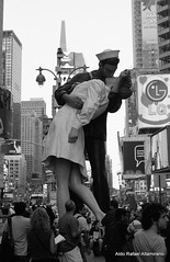 When a Kiss Isnt Just a Kiss (Rafakoy) Tags: pictures street city nyc light people ny newyork film 35mm soldier 50mm gold lights photo kiss war couple with kodak manhattan broadway picture taken negative worldwarii 200 timessquare epson sailor vivitar alfredeisenstaedt kodakgold200 vjday realphotography v3800n vivitarv3800n august141945 epsonv600 epsonperfectionv600photo epsonperfectionv600 vivitarmc50mmf17 aldorafaelaltamirano rafaelaltamirano aldoraltamirano picturestakenwithvivitarv3800n picturetakenwithvivitarv3800n