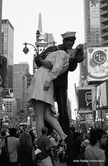 When a Kiss Isn't Just a Kiss (Rafakoy) Tags: pictures street city nyc light people ny newyork film 35mm soldier 50mm gold lights photo kiss war couple with kodak manhattan broadway picture taken negative worldwarii 200 timessquare epson sailor vivitar alfredeisenstaedt kodakgold200 vjday realphotography v3800n vivitarv3800n august141945 epsonv600 epsonperfectionv600photo epsonperfectionv600 vivitarmc50mmf17 aldorafaelaltamirano rafaelaltamirano aldoraltamirano picturestakenwithvivitarv3800n picturetakenwithvivitarv3800n