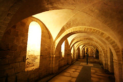 Gormley in the crypt (Peter Denton) Tags: uk england sculpture art statue architecture underground europe quiet arch eu 1986 1980s crypt antonygormley tranquillity winchestercathedral lifeisart canoneos400d