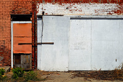Indy#4532_Copy (Single-Tooth Productions) Tags: door wood city urban orange white abstract building brick green abandoned colors architecture composition concrete 50mm nikon architecturaldetail decay steel indianapolis urbandecay shapes indiana minimal doorway brickwall browns weathered westside exit minimalism nikkor decaying abandonedbuilding boardup paintedbrick nikond200 nikkor50mmf18daf exteriorwall covereddoorway boardedupdoorway orangecovereddoor wmichiganst