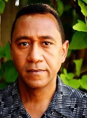 Bienvenido Martinez (Joel Elias Photography) Tags: portrait brown green face leaves closeup shirt pattern dominican dof uncle headshot actor relative thespian