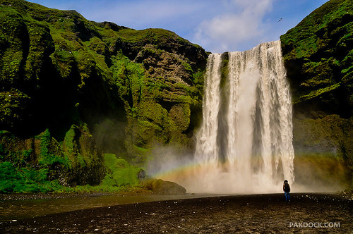 Girl staring at Skogafoss