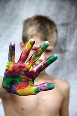 Artist's Handprint (Reagan Thomson Photography) Tags: boy red green art yellow painting kid paint child hand purple bare chest fingers drip messy thin