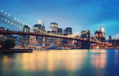 Brooklyn Bridge and Lower Manhattan (Philipp Klinger Photography) Tags: new york city nyc newyorkcity longexposure travel bridge blue light sunset sky urban usa cloud house ny newyork reflection building tree nature water skyline architecture brooklyn night clouds america skyscraper photoshop river landscape island lights evening us dock long exposure nocturnal cross unitedstates manhattan flag united north cable east hour crossprocessing brooklynbridge woolworth processing highrise eastriver states bluehour lower philipp lowermanhattan scraper starsstripes klinger manhattanisland dcdead vanagram