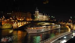 Paris - La Seine et les tours de la Conciergerie 2 (WhiteFlowersFade) Tags: voyage nightphotography travel light paris france architecture night boat nikon cityscape lumire bateau nuit 35mmf18 fixedfocal d40x