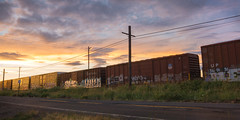 What's Been Left to Us (rosenunezsmith) Tags: lanecounty eugene builtlandscape traintracks powerlines road atmosphericconditions clouds goldenhour train oregon sky sunset pacificnorthwest railroadcars america freight pnw upperleftusa highway magichour street