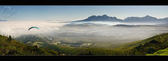 "Sir Lowry""s Pass... (Chantal Steyn) Tags: blue plants mist mountains green nature weather fog clouds landscape southafrica nikon rocks capetown panoramic vegetation polarizer westerncape sirlowryspass d300 cokin paraglyding nohdr paraglyder 1685mm"